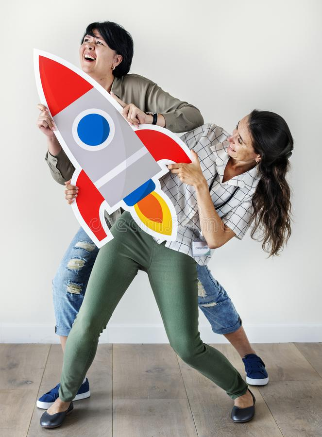 Women holding a rocket icon royalty free stock image