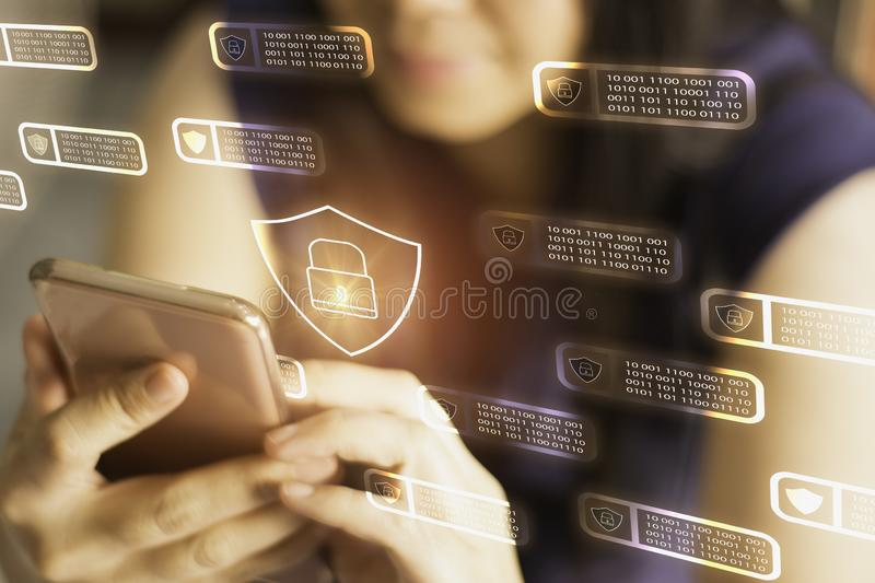 Women holding smartphone in hand with interface screen binary and block chain icon,concept internet financial transaction security. Financial data protection stock photography