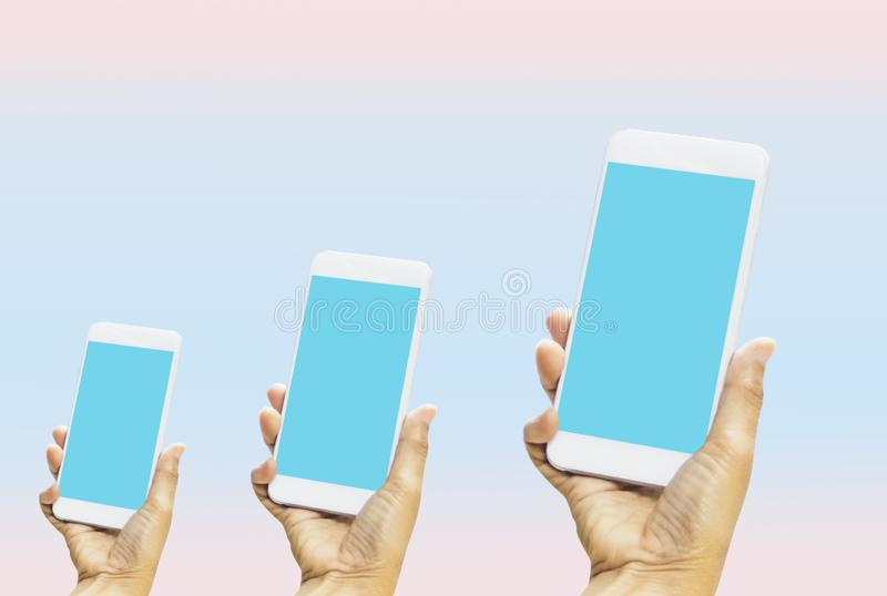 Women holding smartphone in hands with blue screen on bright blue-pink pastel background. With concept of technology and stock illustration