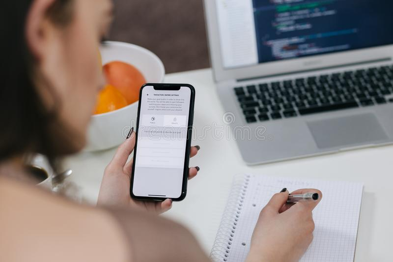 Women Holding Space Gray Iphone X and Black Pen royalty free stock photos