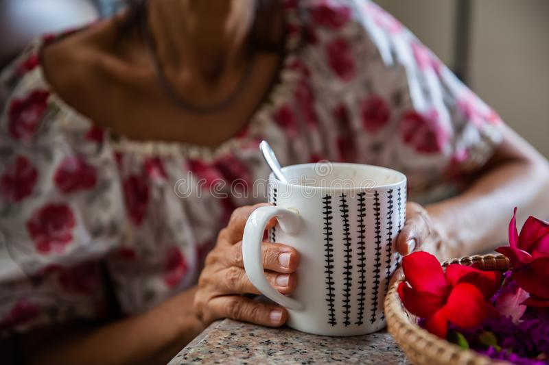 Women and hot drinks on hands. Backgrounds royalty free stock images