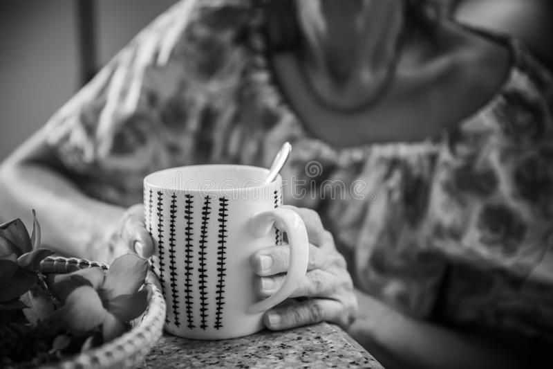 Women and hot drinks on hands. Backgrounds stock photography