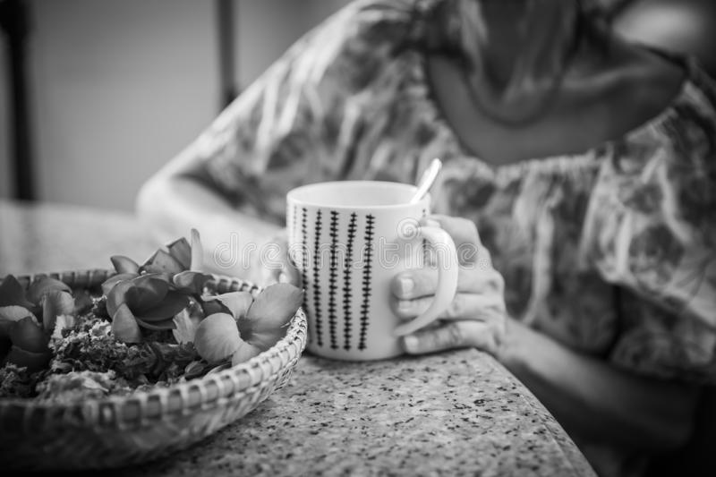 Women and hot drinks on hands. Backgrounds stock photo