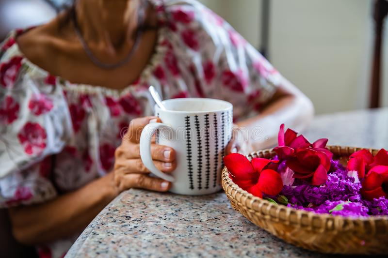 Women and hot drinks on hands. Backgrounds royalty free stock photos