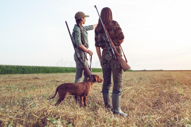 Women hunters with hunting dog stock image