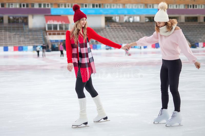Women ice skating outdoor at ice rink stock images