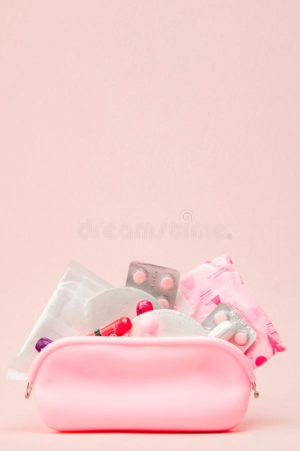 Women intimate hygiene products - sanitary pads and tampons on pink background, copy space. Menstrual period concept. Top view,. Flat lay, copy space stock photos