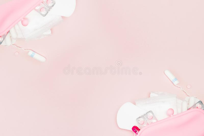 Women intimate hygiene products - sanitary pads and tampons on pink background, copy space. Menstrual period concept. Top view,. Flat lay, copy space stock image