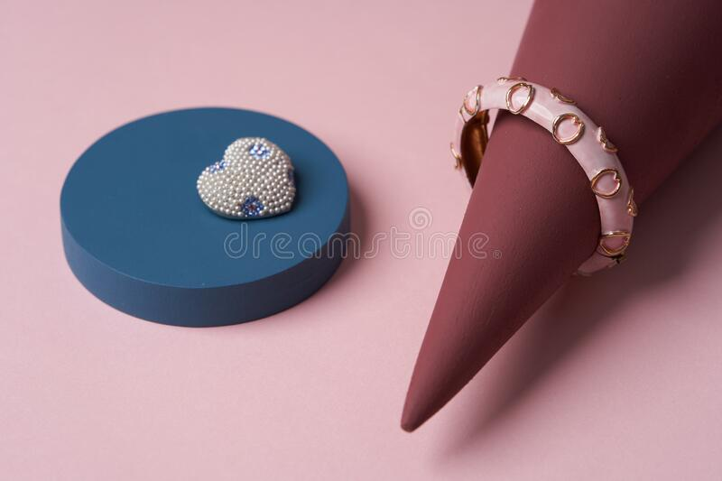 Women jewelry accessories. Heart shaped diamond brooch and bracelet stock images
