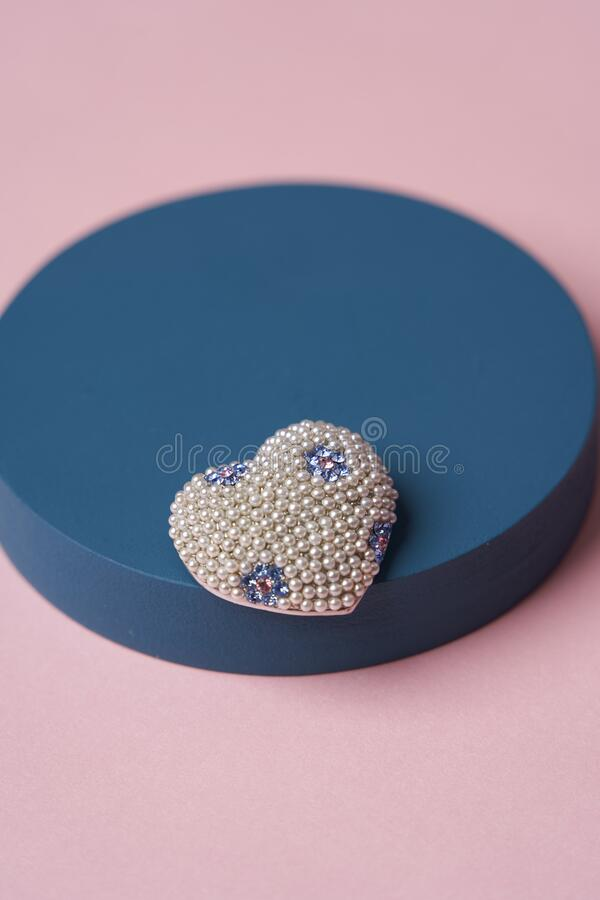 Women jewelry accessories. Heart shaped diamond brooch and bracelet royalty free stock images