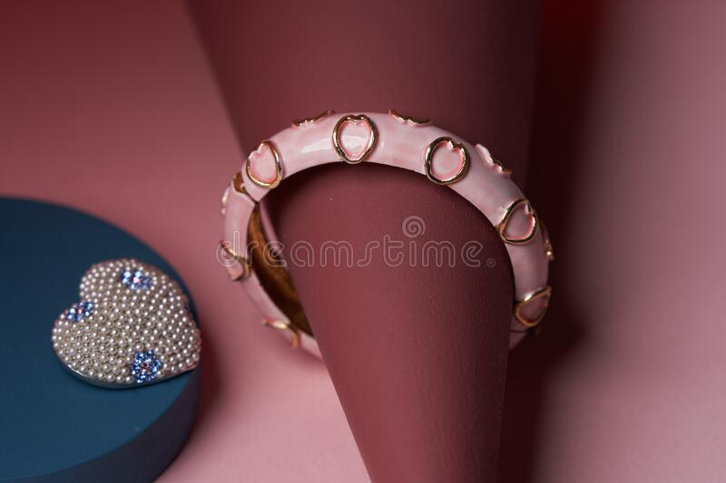 Women jewelry accessories. Heart shaped diamond brooch and bracelet royalty free stock image