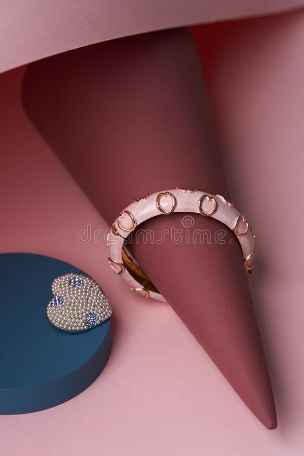 Women jewelry accessories. Heart shaped diamond brooch and bracelet stock photo