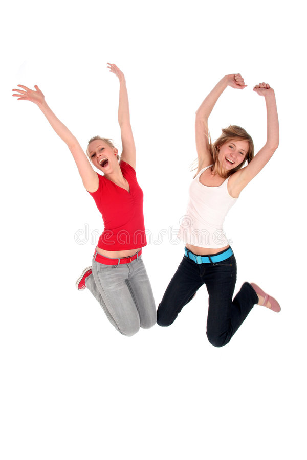 Women jumping. Two young women jumping for joy stock image