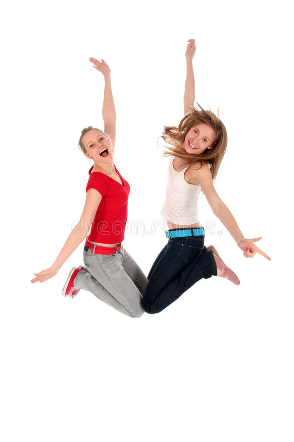 Women jumping. Two young women jumping for joy stock photos