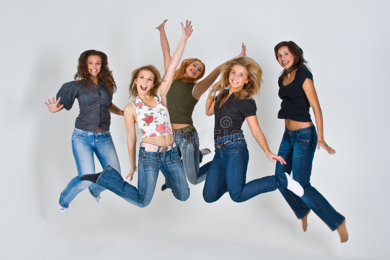 Women jumping in air royalty free stock photos