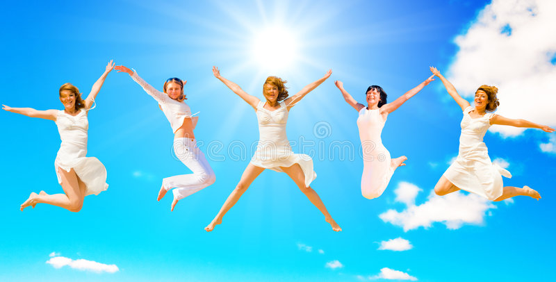 Women jumping in a group royalty free stock photos