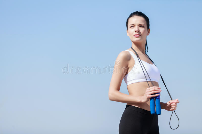 Women with jumping rope. Beautiful young women standing with a j royalty free stock photography