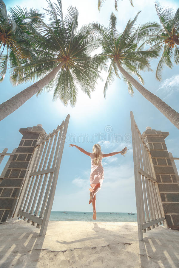 Women jumping on the sunny tropical stock photography