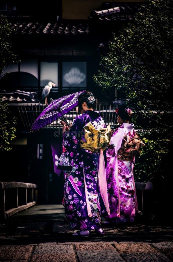 Women in kimono robes in garden stock photography