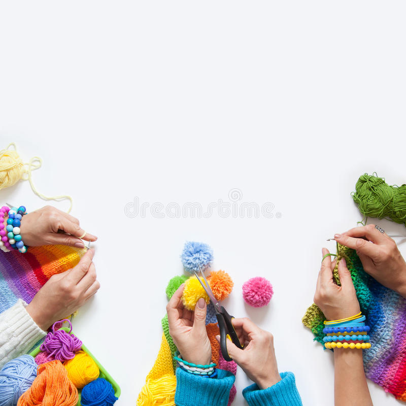 The women knit and crochet colored fabric. View from above. royalty free stock photos