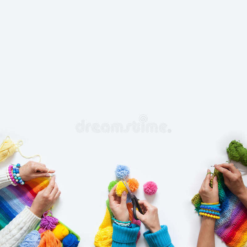 The women knit and crochet colored fabric. View from above. stock photography