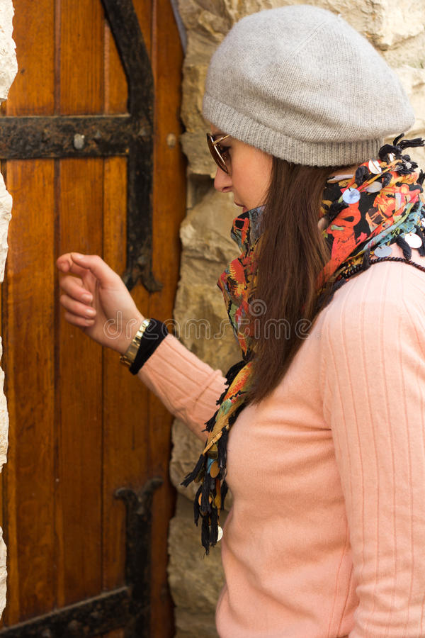 Women Knocking On An Old Wooden Door Royalty Free Stock Photos