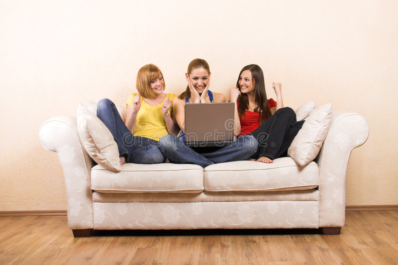 Women with a laptop on a sofa stock photos
