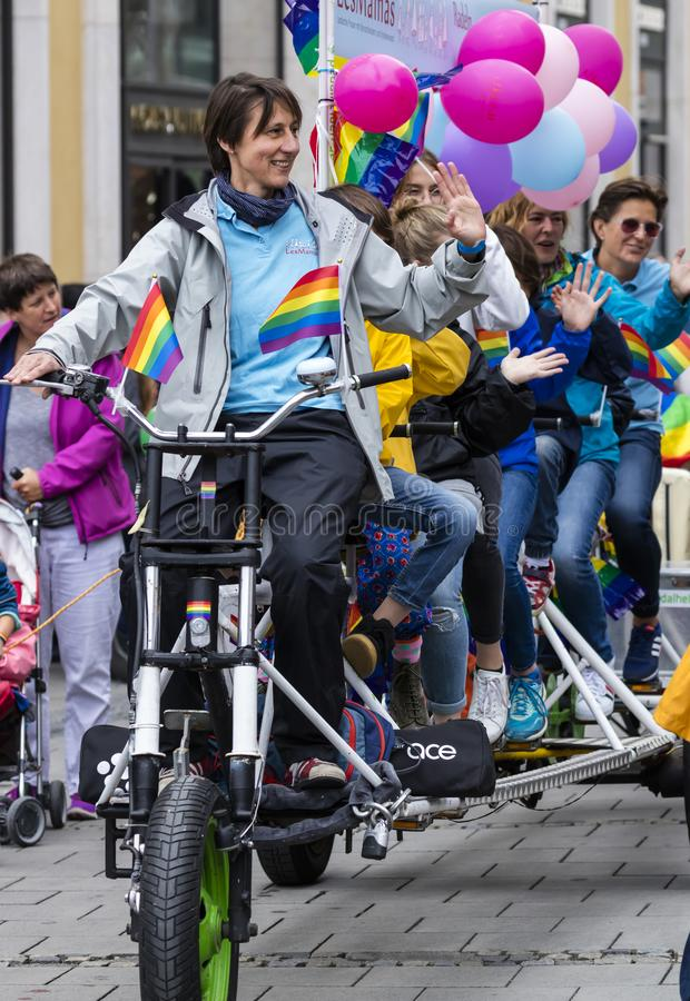 2019: Women on a large bike attending the Gay Pride parade also known as Christopher Street Day CSD in Munich, Germany royalty free stock image