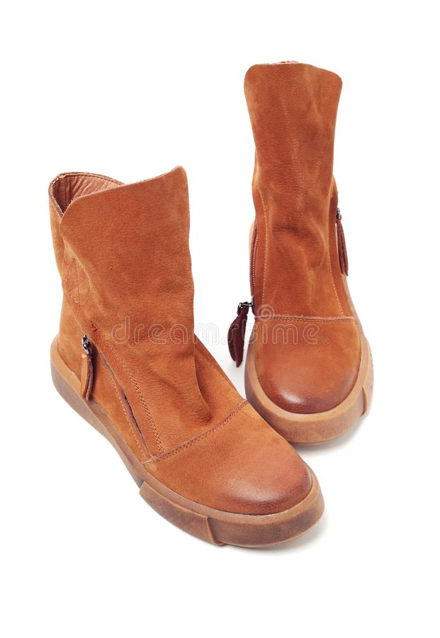 Women leather brown boots royalty free stock photos
