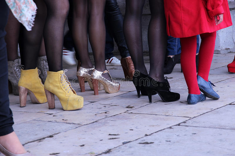 Women legs in a crowd place. Girl closeup people stock images