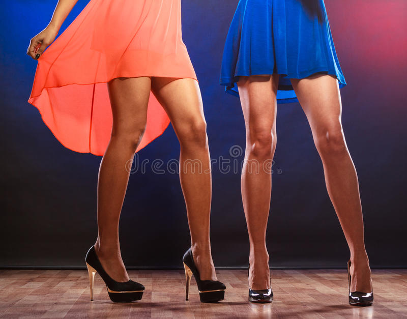 Women legs on high heels. Party, celebration, disco concept. Women in evening dresses dancing in the club, part of body female legs in high heels on party floor royalty free stock photo