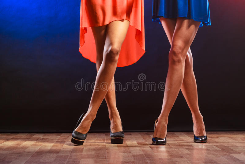 Women legs on high heels. Party, celebration, disco concept. Women in evening dresses dancing in the club, part of body female legs in high heels on party floor royalty free stock image