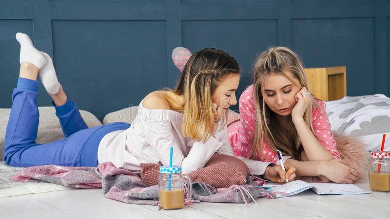 Women leisure girls hanging out floor home drawing stock photos
