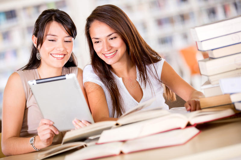 Download Women At The Library With A E-book Reader Stock Image - Image: 27762915