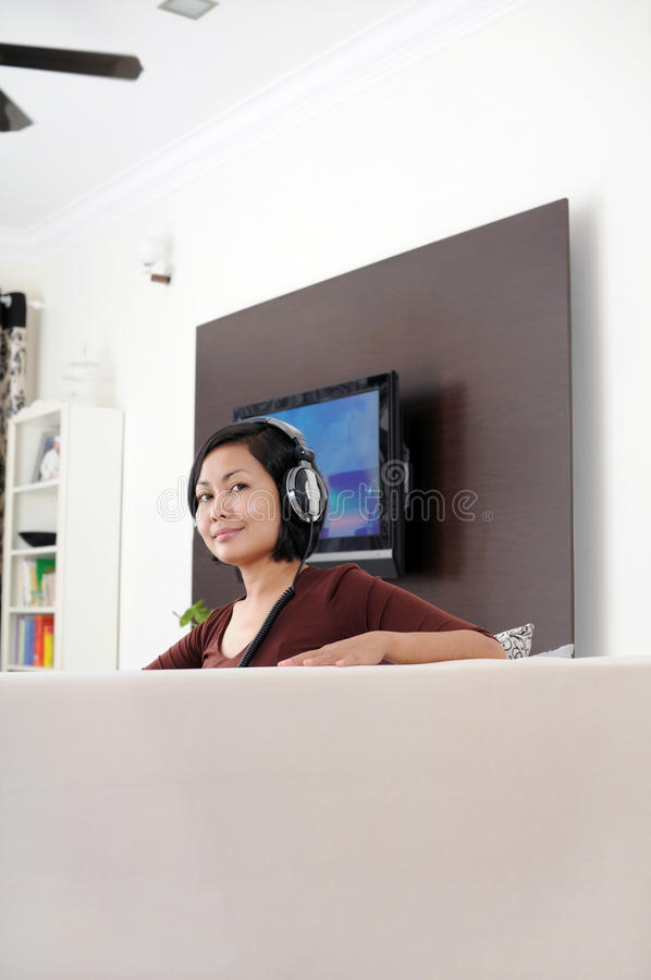 Women listening music stock photography
