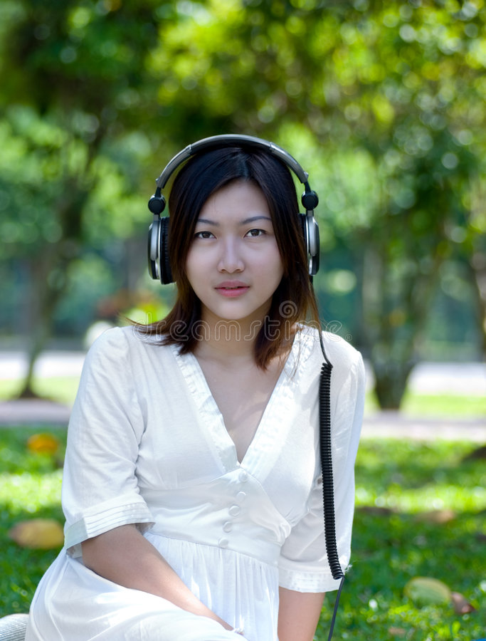 Women listening to music royalty free stock photo