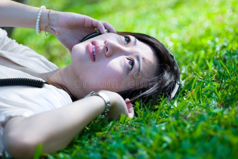 Women listening to music royalty free stock photos