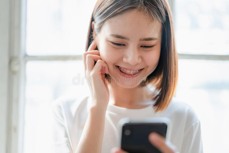 Women are listening to music from white headphones. And using hands touch to use various functions, happy mood. Women are listening to music from white royalty free stock image