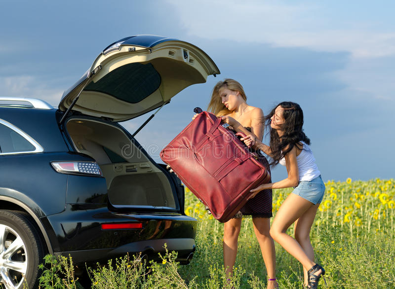 Download Women Loading A Heavy Bag Into Car Stock Photo - Image: 26194428