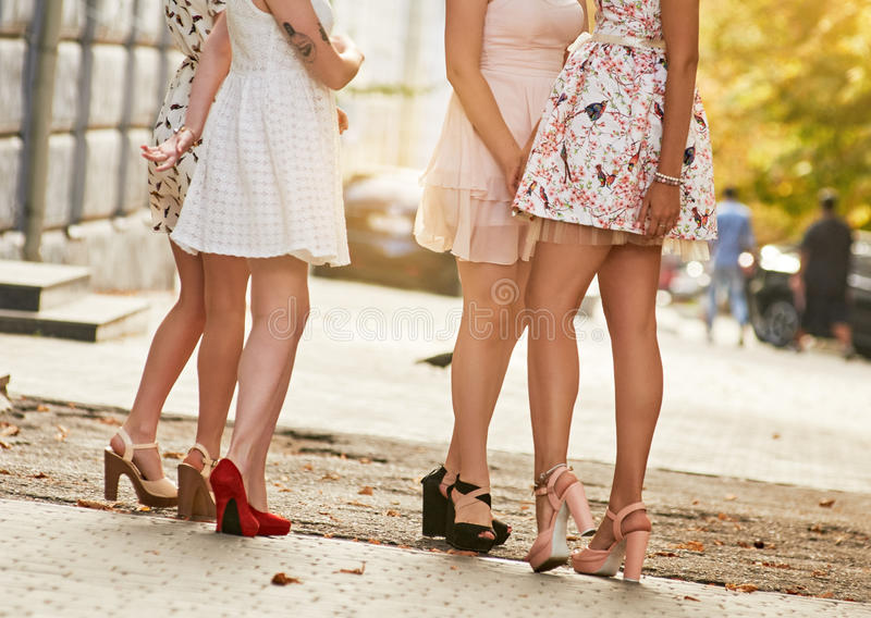 Women Long Legs. Girls women friends with legs standing. outdoor street city stock images
