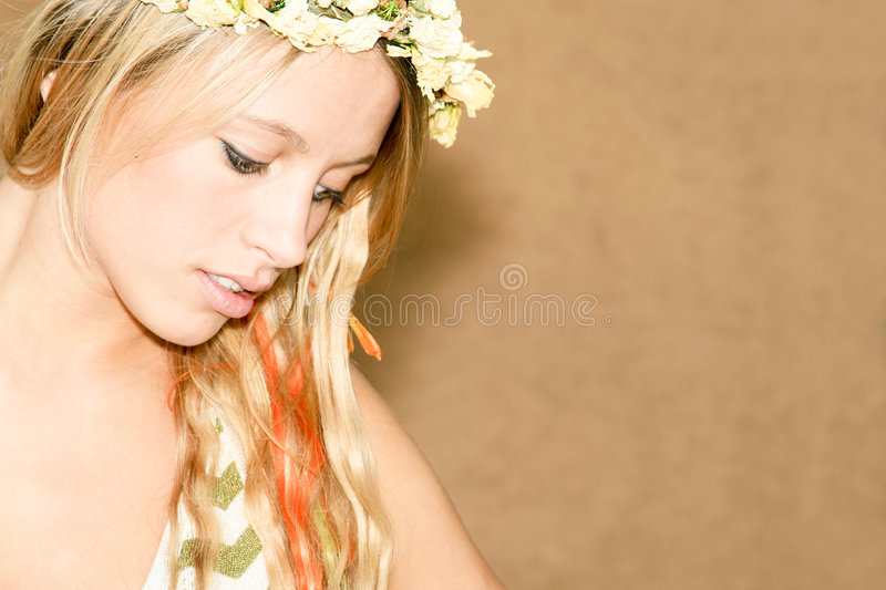 Women look down. Natural beautiful women with diadem royalty free stock image