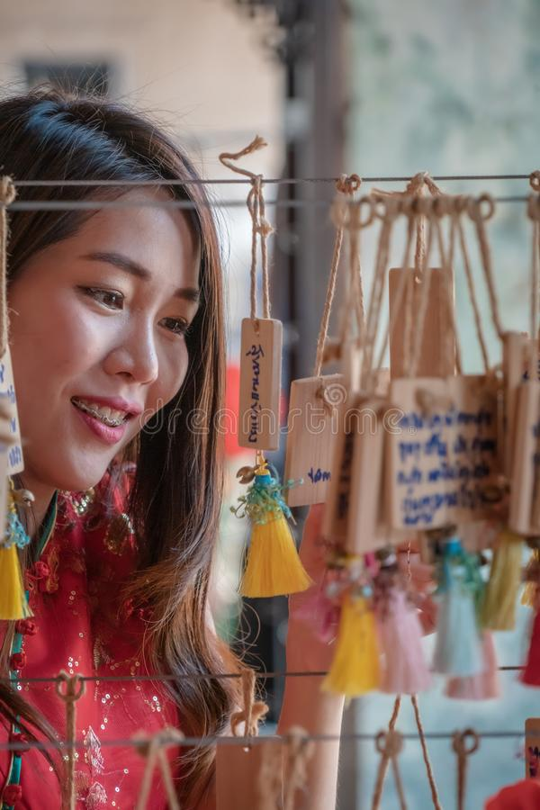 Women looking to lucky knot ornaments for Chinese New Year stock photography