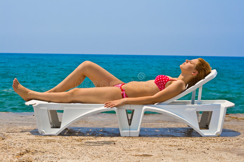 Woman on lounger royalty free stock photography