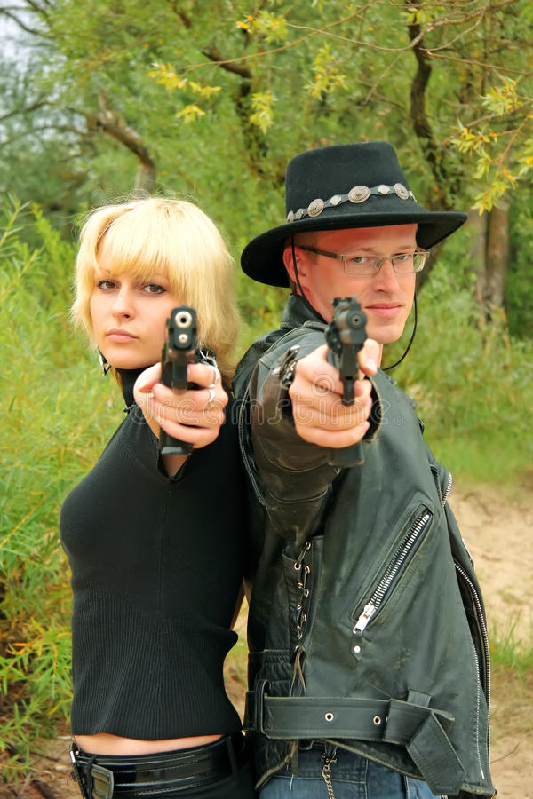 Download Women And Man Back-to-back Aiming Handguns Stock Image - Image: 12041371