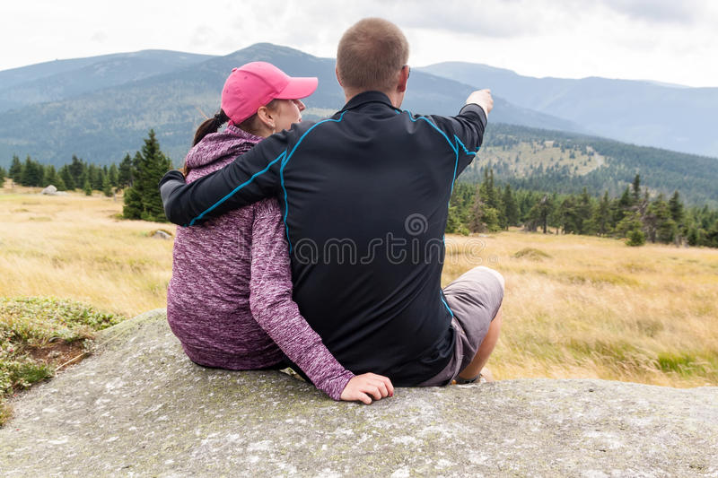 Women and man looks out over the mountains royalty free stock photo