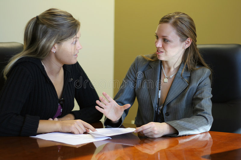 Women in a meeting. Two women in a meeting royalty free stock photo