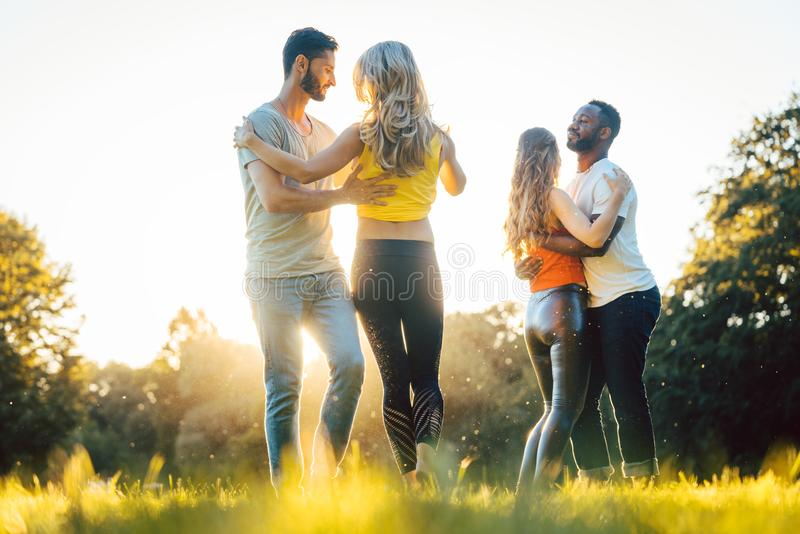 Women and men having fun dancing in the park. As couples royalty free stock photos