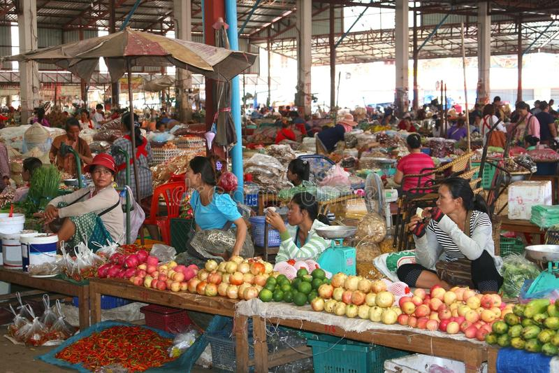 Business women are active with selling tropical fruits at the indoor market, Vientiane, Laos royalty free stock image