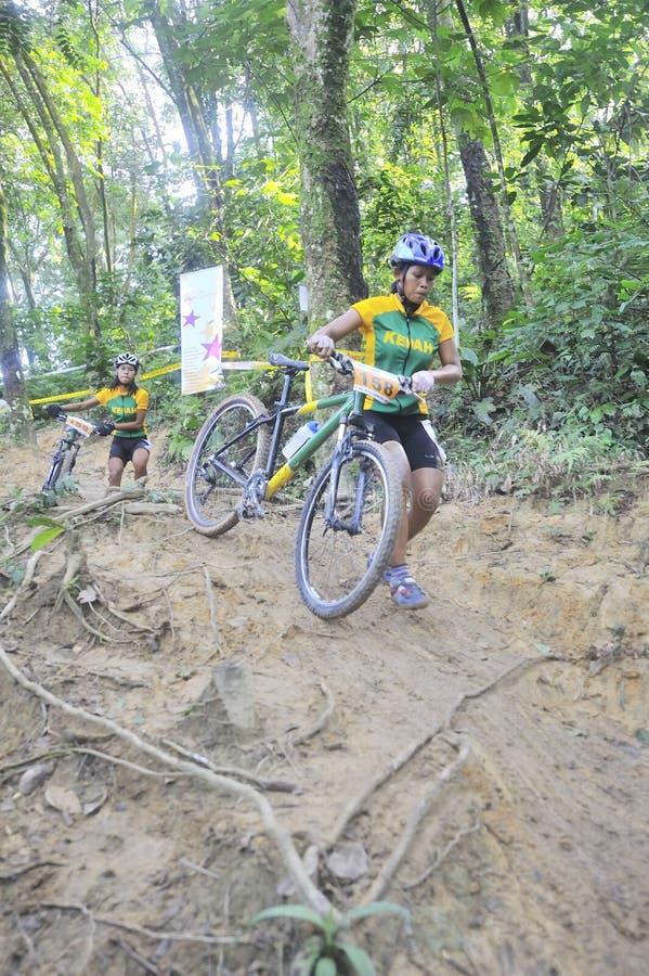 Women Mountain Bike Racer stock photo