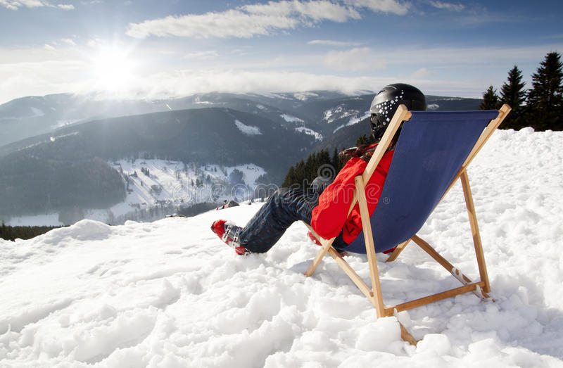Download Women At Mountains In Winter Lies On Sun-lounger Stock Photo - Image: 29690506